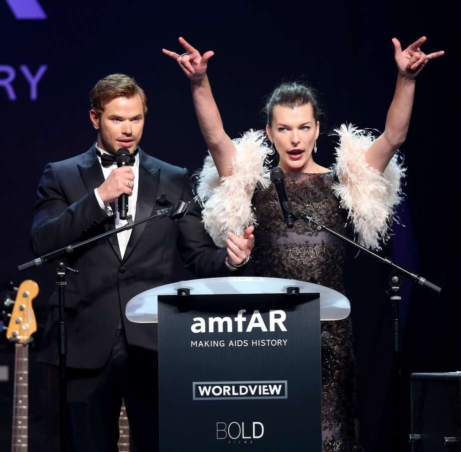 Kellan Lutz (L) and Milla Jovovich speak onstage during amfAR's 21st Cinema Against AIDS Gala. Photo: Tim P. Whitby, Getty Images For AmfAR