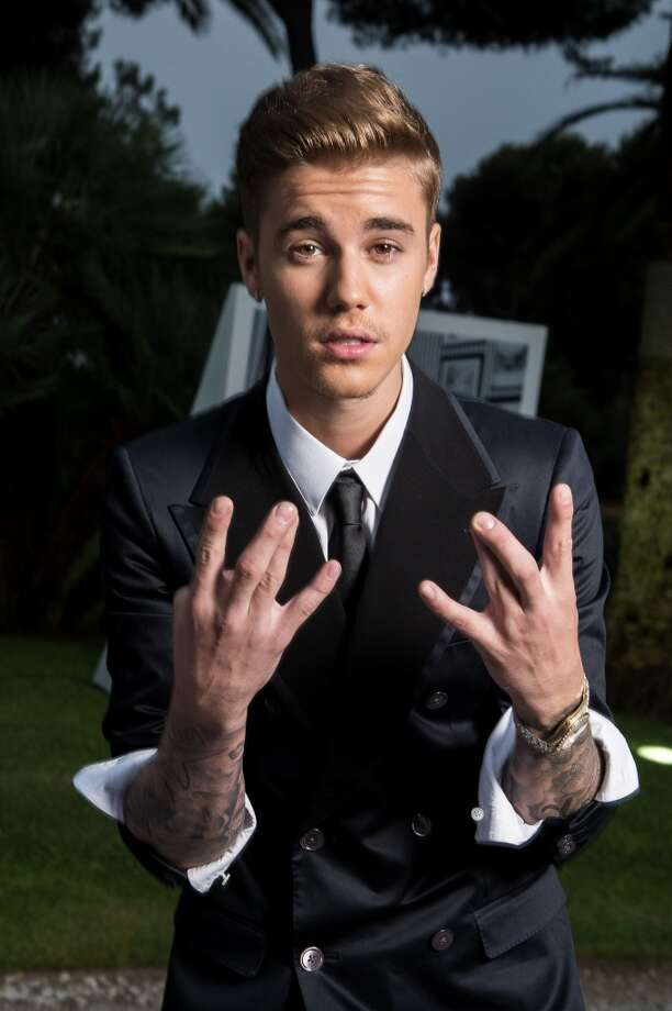 Justin Bieber poses for a portrait at amfAR's 21st Cinema Against AIDS Gala. Photo: Pascal Le Segretain/amfAR14, WireImage
