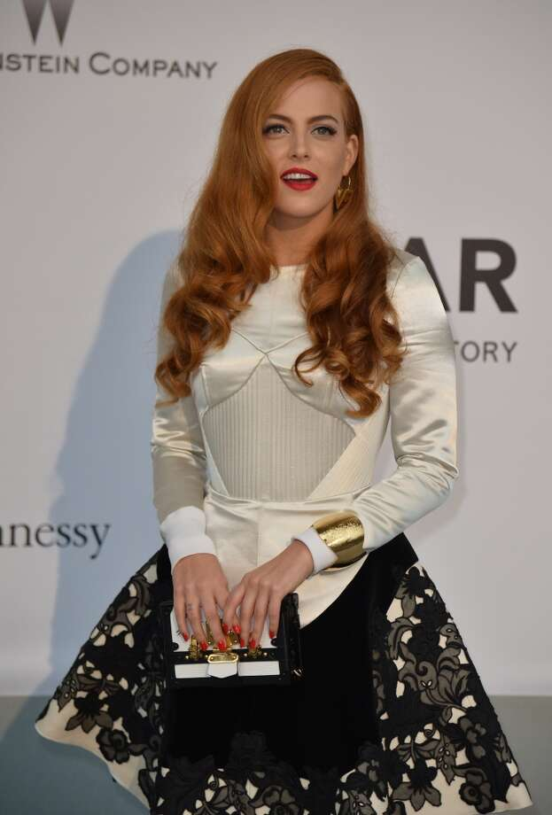 US actress and model Riley Keough poses as she arrives for the amfAR 21st Annual Cinema Against AIDS during the 67th Cannes Film Festival at Hotel du Cap-Eden-Roc in Cap d'Antibes, southern France, on May 22, 2014. Photo: ALBERTO PIZZOLI, AFP/Getty Images