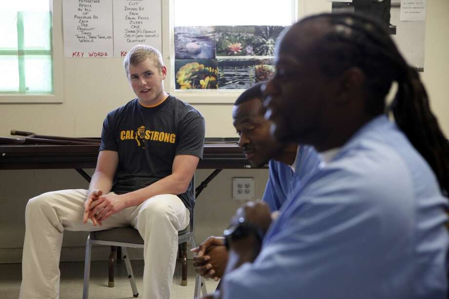 Safety Cormac Craigie, left, listens as inmates Sha Wallace, left, and Vaughn Miles speak during a Squires Youth Diversion Program meeting as Cal Bears football players make a visit to San Quentin State Prison in San Quentin, CA, Saturday May 3, 2014. Photo: The Chronicle