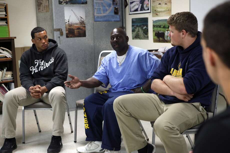 Players including Hardy Nickerson, left, and Brad Northnagel, listen to inmate Ventrice Laster speak to them during a Squires Youth Diversion Program meeting, as Cal Bears football players make a visit to San Quentin State Prison in San Quentin, CA, Saturday May 3, 2014. Photo: The Chronicle