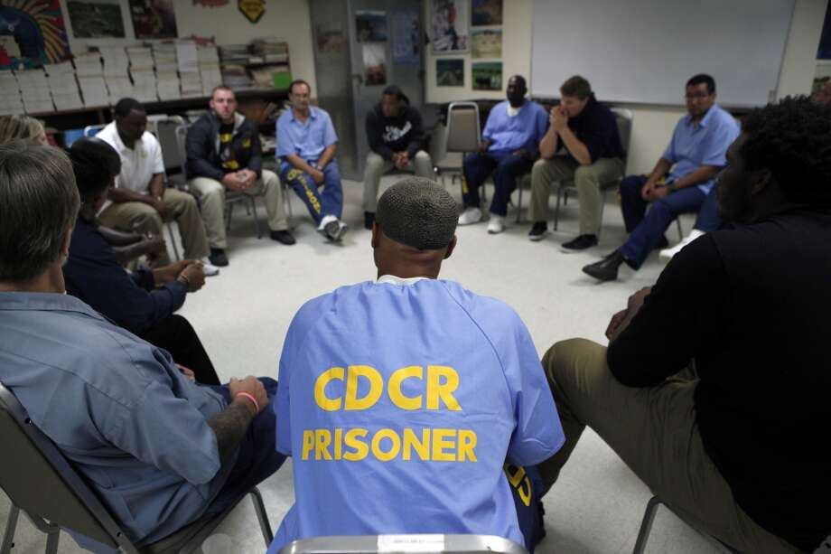 Cal Bears football players sit and talk with inmates during a Squires Youth Diversion Program meeting as the team makes a visit to San Quentin State Prison in San Quentin, CA, Saturday May 3, 2014. Photo: The Chronicle
