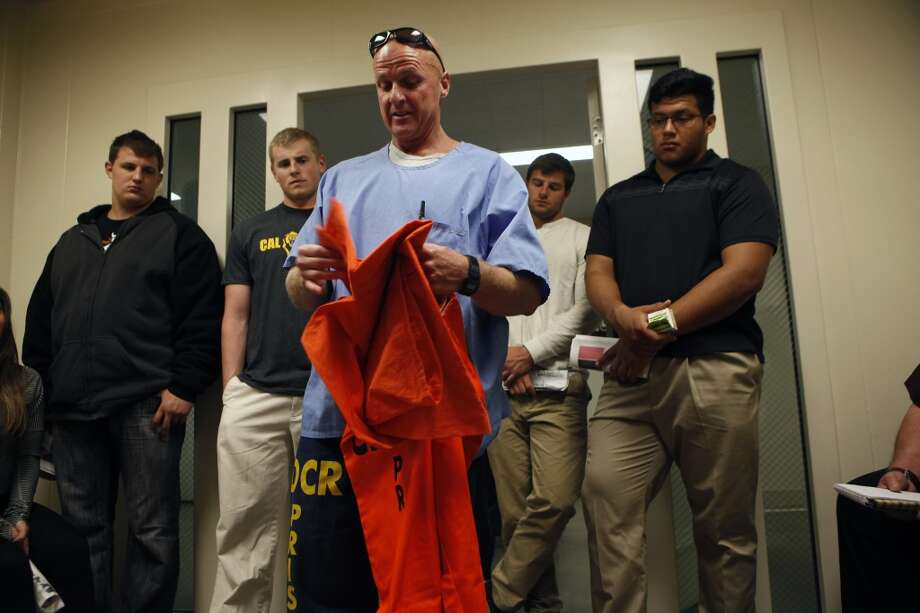"Cal Bears football players listen to inmate David ""Lumpy"" Stephens as he shows them the clothing that new inmates receive upon arrival, as the team makes a visit to San Quentin State Prison in San Quentin, CA, Saturday May 3, 2014. Photo: The Chronicle"