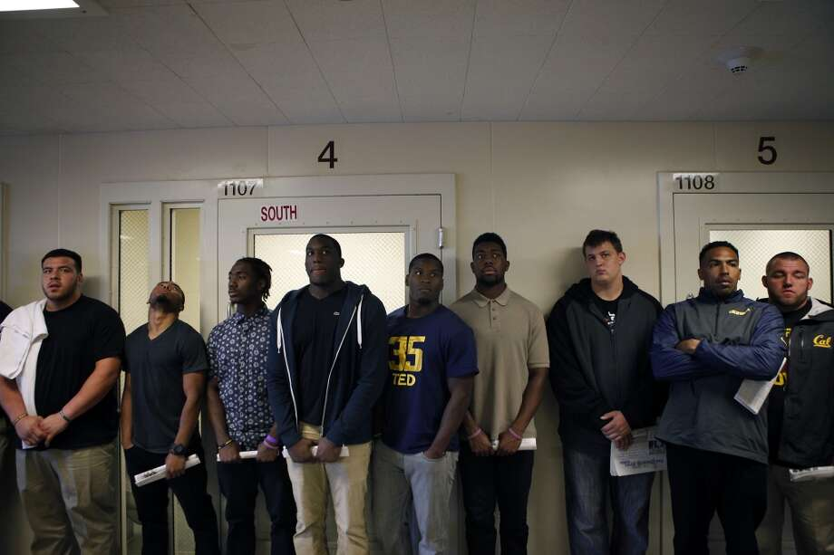 Cal Bears football players stand in a receiving room where new prisoners are searched and processed, as the team makes a visit to San Quentin State Prison in San Quentin, CA, Saturday May 3, 2014. Photo: The Chronicle