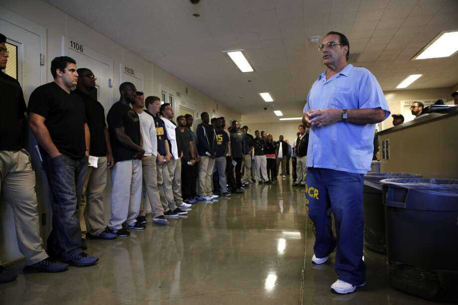 Cal Bears football players stand in a receiving room as they listen to inmate David Basile describe how arriving prisoners are  searched and processed, as the team makes a visit to San Quentin State Prison in San Quentin, CA, Saturday May 3, 2014. Photo: The Chronicle