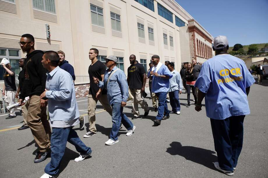 Inmates that are part of the Squire Youth Diversion Program walk with Cal Bears football players and staff as they make a visit to San Quentin State Prison in San Quentin, CA, Saturday May 3, 2014. Photo: The Chronicle