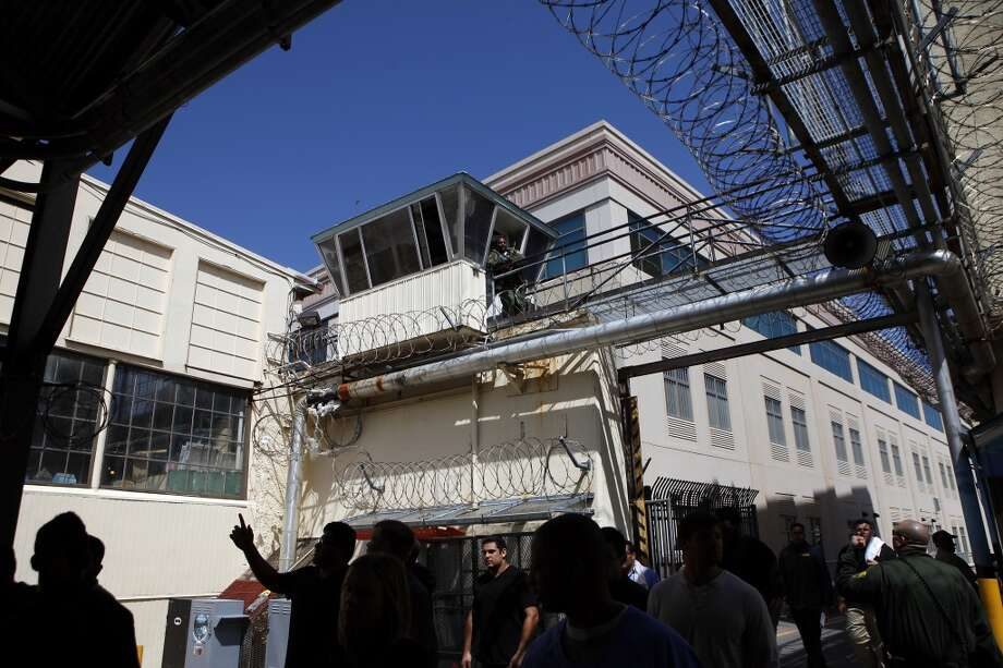 A guard stands watch in a tower as Cal Bears football players make a visit to San Quentin State Prison in San Quentin, CA, Saturday May 3, 2014. Photo: The Chronicle