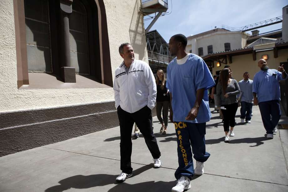 Head coach Sonny Dykes talks with inmate Sha Wallace as Cal Bears football players make a visit to San Quentin State Prison in San Quentin, CA, Saturday May 3, 2014. Photo: The Chronicle