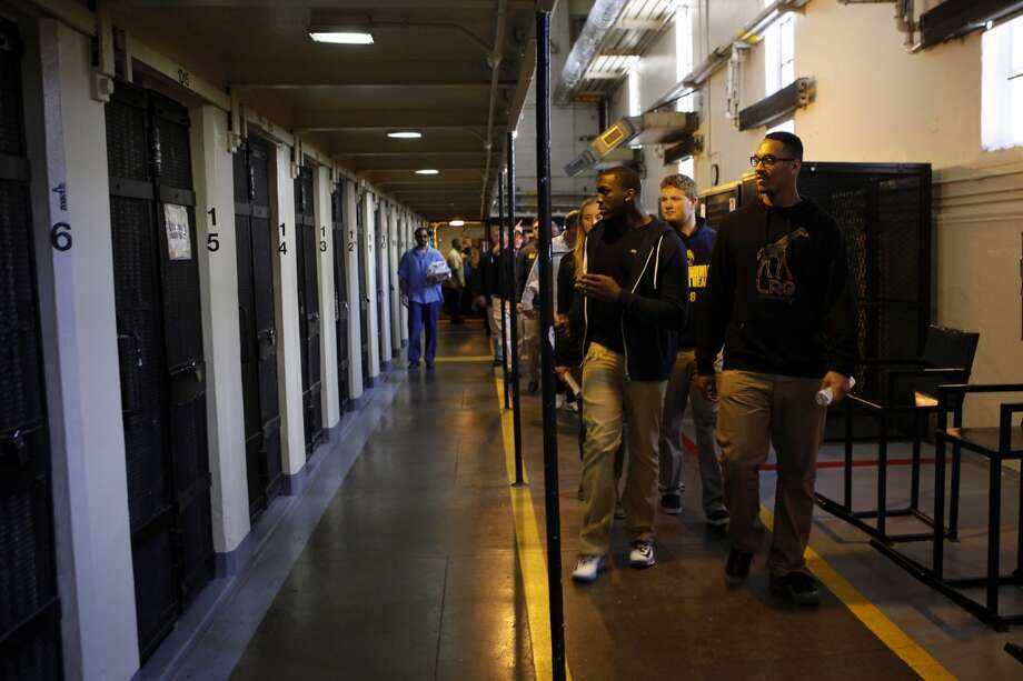 Cal Bears football players look at prisoners in their cells as they walk through a housing block during a visit to San Quentin State Prison in San Quentin, CA, Saturday May 3, 2014. Photo: The Chronicle