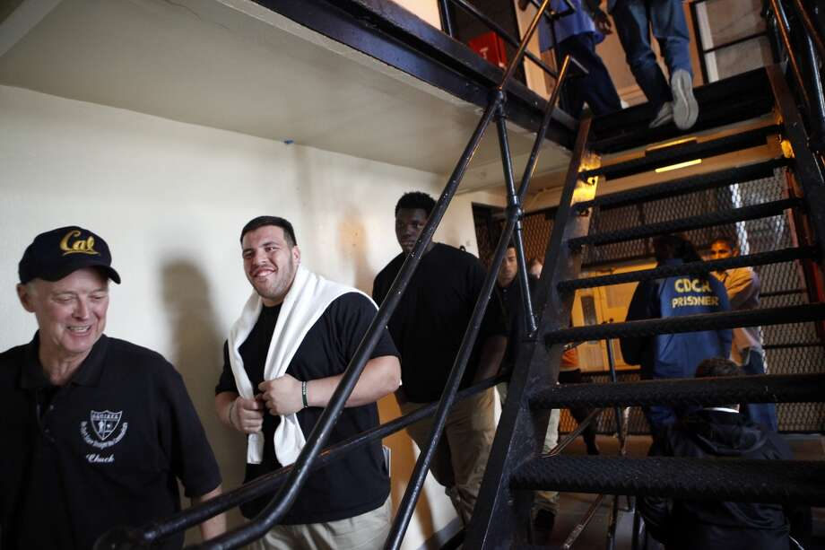 Cal Bears football players including Trevor Kelly, center, and Aaron Cochran, right, climb stairs in a housing block during a visit to San Quentin State Prison in San Quentin, CA, Saturday May 3, 2014. Photo: The Chronicle