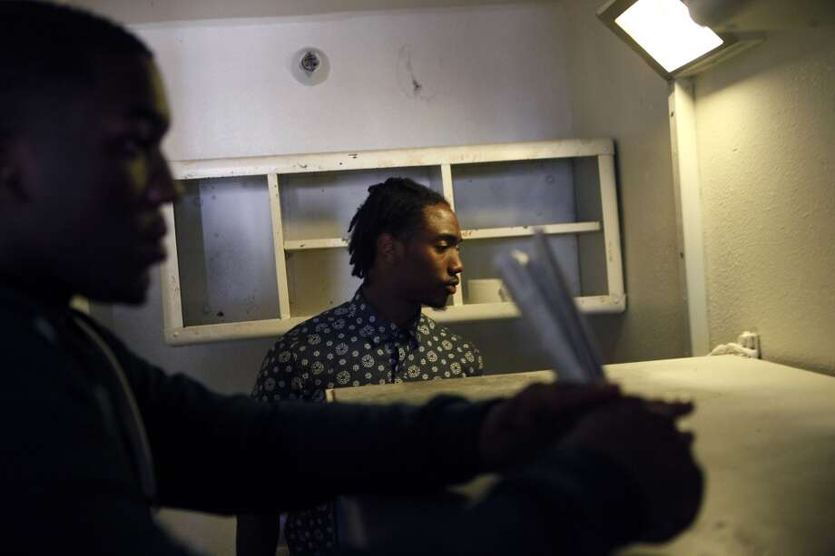 Cornerback Cameron Walker, right, and defensive end Jonathan Johnson look around a cramped cell as Cal Bears football players make a visit to San Quentin State Prison in San Quentin, CA, Saturday May 3, 2014. Photo: The Chronicle
