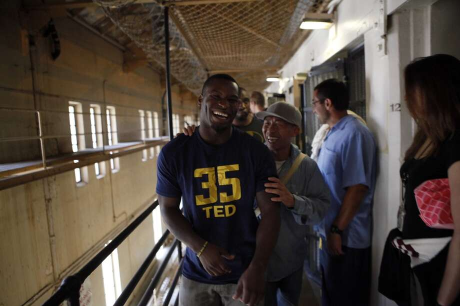 Safety Damariay Drew laughs with an inmate inside a housing block as Cal Bears football players make a visit to San Quentin State Prison in San Quentin, CA, Saturday May 3, 2014. Photo: The Chronicle