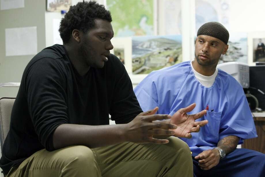 Linebacker Aaron Cochran, left, opens up about family problems to inmate Rasheed Lockheart during a Squires Youth Diversion Program meeting, as Cal Bears football players make a visit to San Quentin State Prison in San Quentin, CA, Saturday May 3, 2014. Photo: The Chronicle