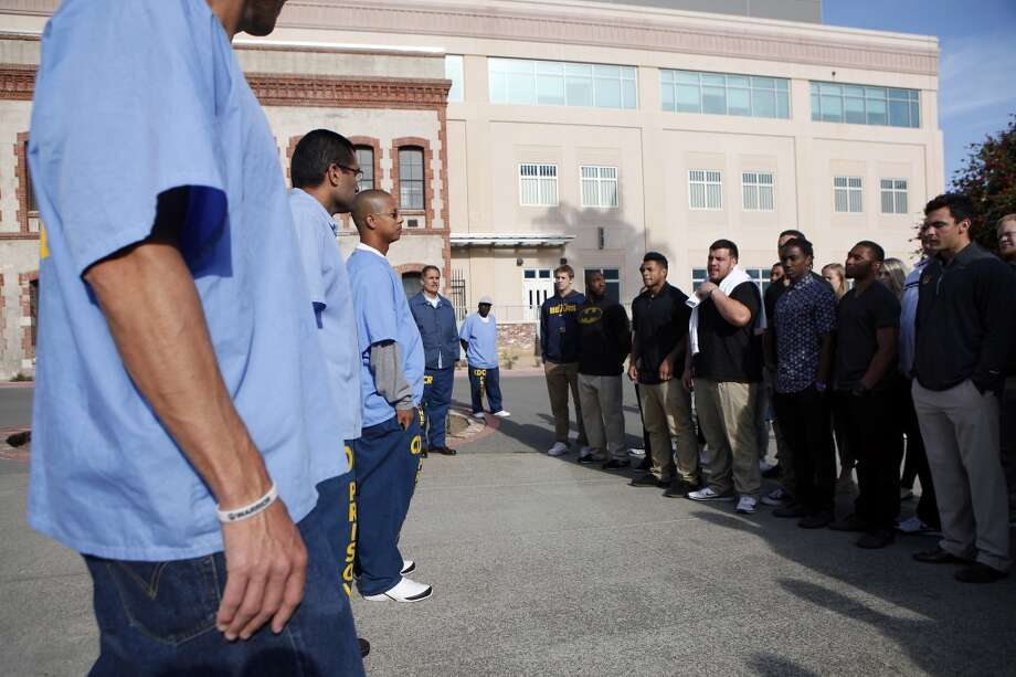 Inmates that are part of the Squire Youth Diversion Program greet Cal Bears football players and staff as they make a visit to San Quentin State Prison in San Quentin, CA, Saturday May 3, 2014. Photo: The Chronicle