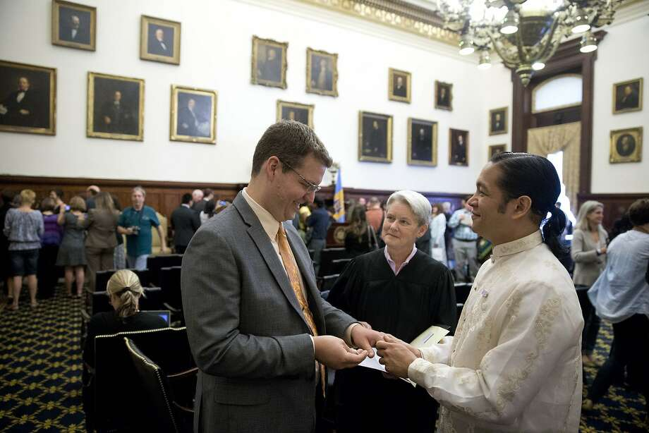 Adam Woods (left) and Justin Jain marry in Philadelphia after Pennsylvania's ban was nullified. Photo: Matt Rourke, Associated Press