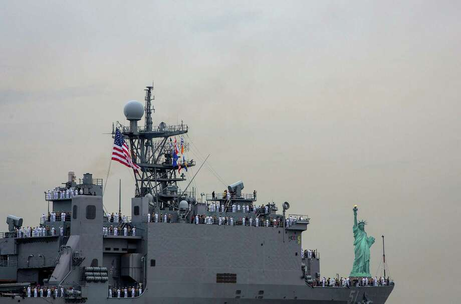 The USS Oak Hill passes the Statue of Liberty on May 21, 2014 in New York City. Fleet Week festivities officially began with a parade of ships into New York Harbor and up the Hudson River.. Photo: Eric Thayer, Wire Images / 2014 Getty Images
