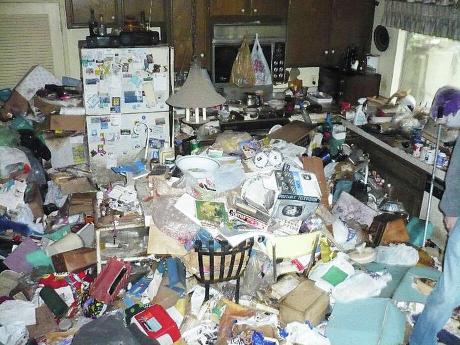 This view of the kitchen of a hoarder illustrates the problem Westport emergency personnel can face when answering a call. The Westport Safer Homes Task Force has been formed to address the problem of hoarding. Photo: Contributed Photo / Westport News