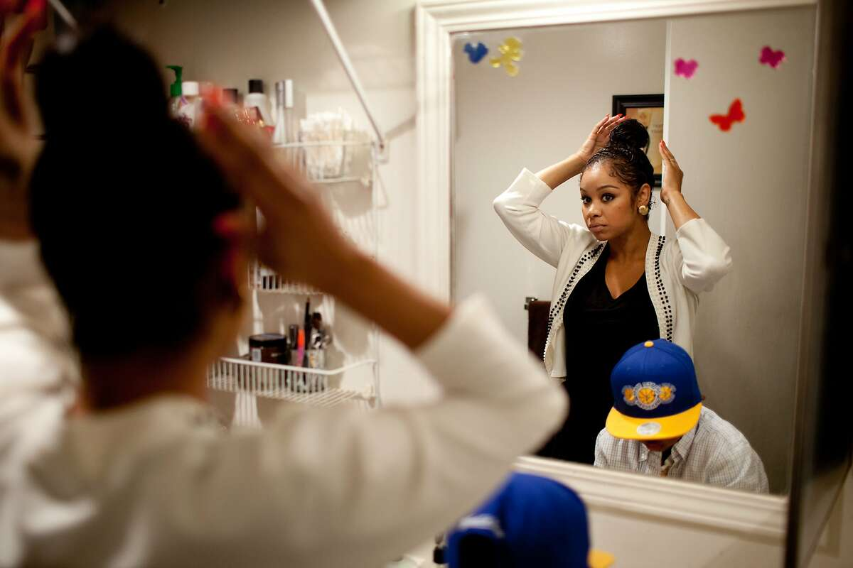 Essence Hope, 29, gets ready for the day with her son Bryce, 6, at their apartment in Oakland, Calif. on Friday, May 23, 2014. Hope has worked minimum wage jobs ever since she left high school.
