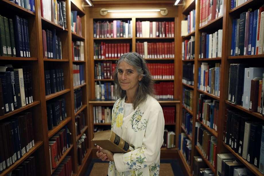 Kim Bancroft holds an original copy of Hubert Howe Bancroft's autobiography at UC Berkeley's Bancroft Library. Photo: Michael Short, The Chronicle
