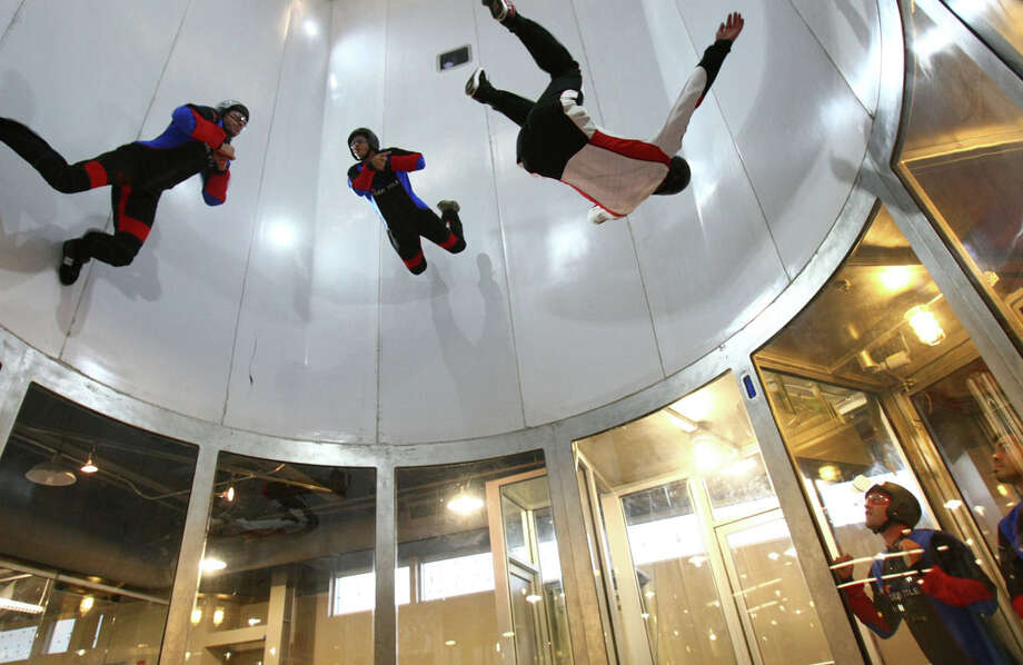 iFly Seattle indoor skydiving instructors demonstrate their flying technique. Photo: JOSHUA TRUJILLO, SEATTLEPI.COM / SEATTLEPI.COM