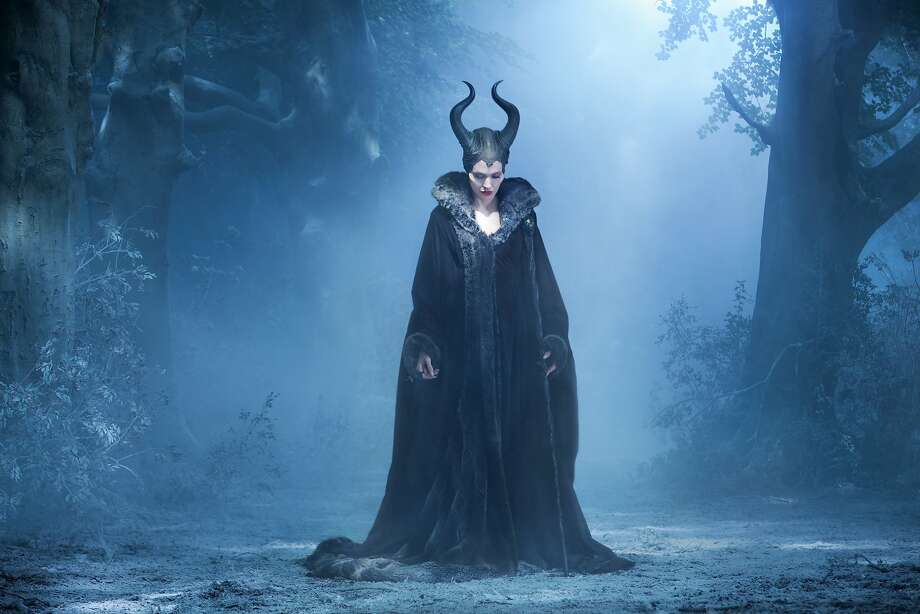 "Angelina Jolie is the title character in ""Maleficent,"" which takes the tale of ""Sleeping Beauty"" and reimagines it as Maleficent's story, and how a wise young woman turned so cold. Photo: Frank Connor, Walt Disney Pictures"