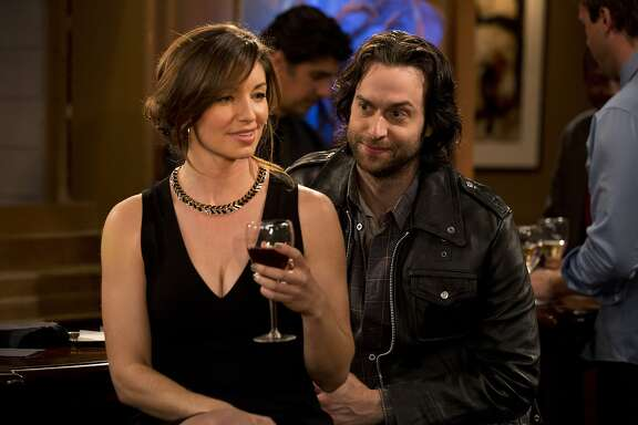 UNDATEABLE -- Pilot -- Pictured: (l-r) Bianca Kajlich as Leslie Burton, Chris D'Elia as Danny Burton