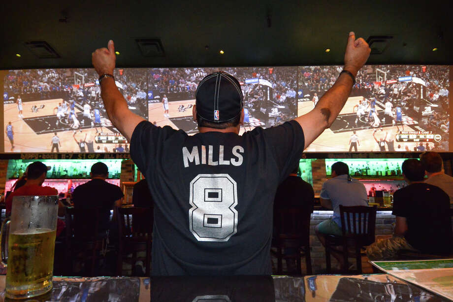 Wearing a Patty Mills number 8 t-shirt, Joel Gonzalez cheers on the Spurs in the Australian-themed Roo Pub at Redland Rd. and 281. Photo: Robin Jerstad