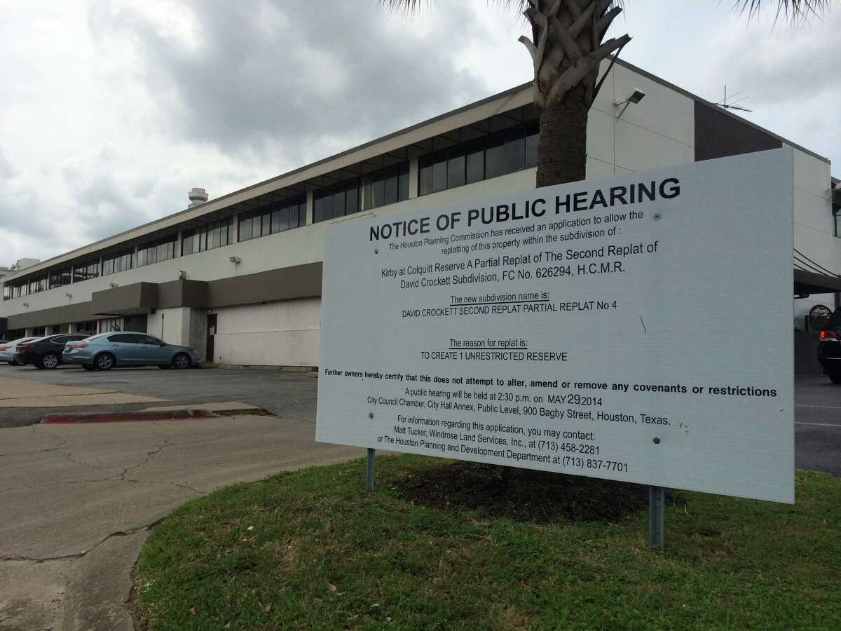 A notice of public hearing sign on the Kirby property where Thor Equities is planning a mixed-use development.
