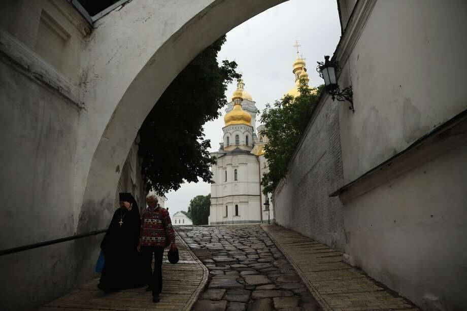 People walk through the grounds of  the historic Orthodox Christian monastery, 'Kiev Pechersk Lavra' (The Kiev Monastery of the Caves), on May 21, 2014 in Kiev, Ukraine. Ukraine's Presidential elections are to be held on Sunday 25 May, 2014. Photo: Getty Images