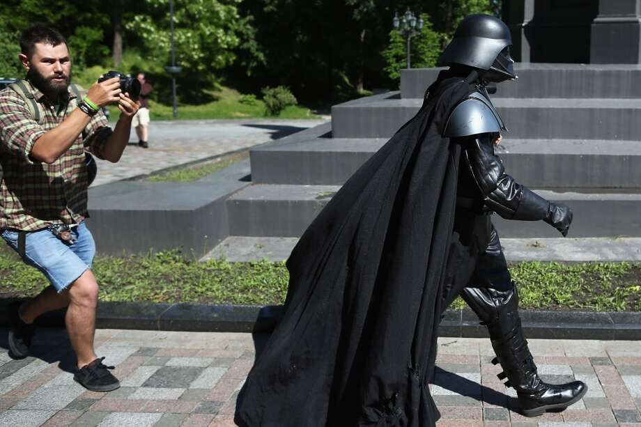 Kiev's mayoral candidate for the Internet Party, 'Darth Vader' arrives to speak to the media on Volodymyrska Hill on May 22, 2014 in Kiev, Ukraine. Amongst his pledges Mr Vader promises 'Fish for everyone', and 'Anti gravity tripods for journalists'. Ukraine's Presidential elections are to be held on Sunday 25 May, 2014. Photo: Getty Images