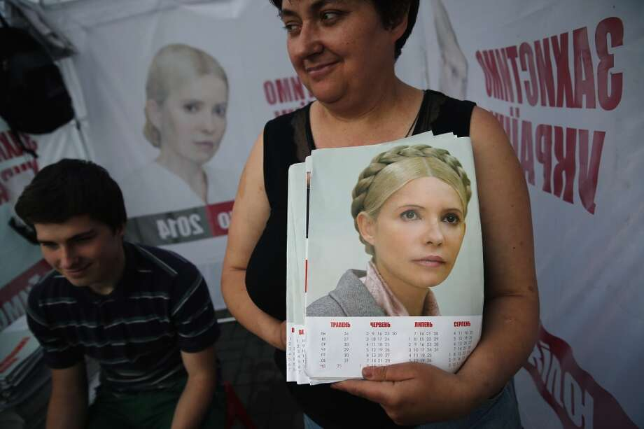 A woman hands out election campaign leaflets promoting Yulia Tymoshenko, the former PM of Ukraine on May 21, 2014 in Kiev, Ukraine. Ukraine's Presidential elections are to be held on Sunday 25 May, 2014. Photo: Getty Images