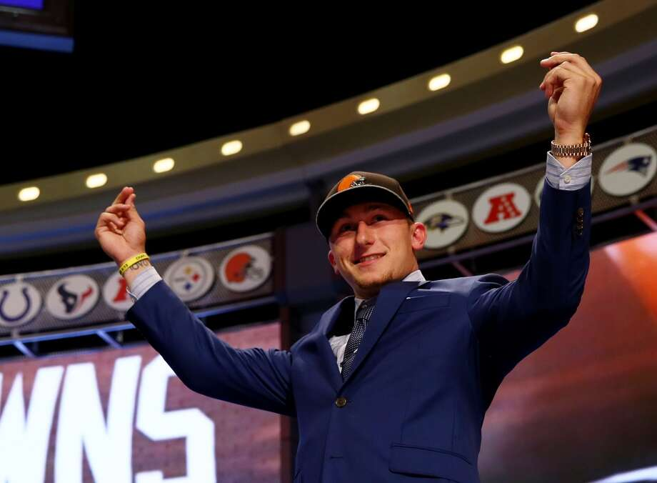 Johnny Manziel of the Texas A&M Aggies takes the stage after he was picked #22 overall by the Cleveland Browns during the first round of the 2014 NFL Draft at Radio City Music Hall on May 8, 2014 in New York City. Photo: Elsa, Getty Images