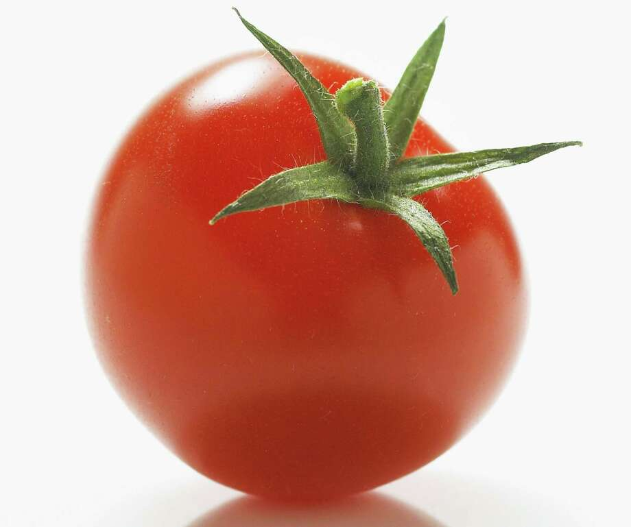 The lycopene in cooked tomatoes cuts the risk of prostate cancer. Photo: Getty Images / (c) Andrew Bret Wallis