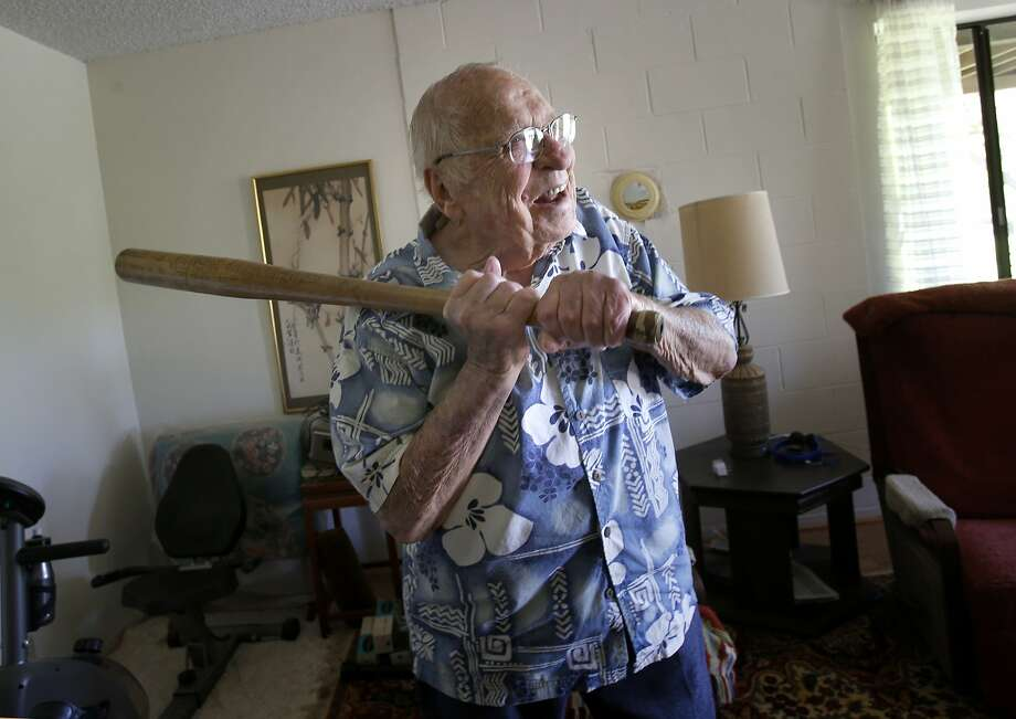 Cliff Stewart, 97, shows off his batting stance from when he and shipmates were stranded in a Russian port near the Arctic Ocean. Photo: Brant Ward, The Chronicle