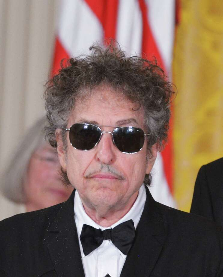 (FILES) This photo taken on May 29, 2012, in the East Room of the White House in Washington, shows muscian Bob Dylan receiving the Presidential Medal of Freedom from US President Barack Obama during a ceremony. Bob Dylan could potentially be awarded the French 'Legion d'honneur' award, according to a statement by the grand chancelor of the Legion d'honneur, the general Jean-Louis Georgelin, on June 2, 2013.   AFP PHOTO / Mandel NGANMANDEL NGAN/AFP/Getty Images Photo: MANDEL NGAN / F AFP