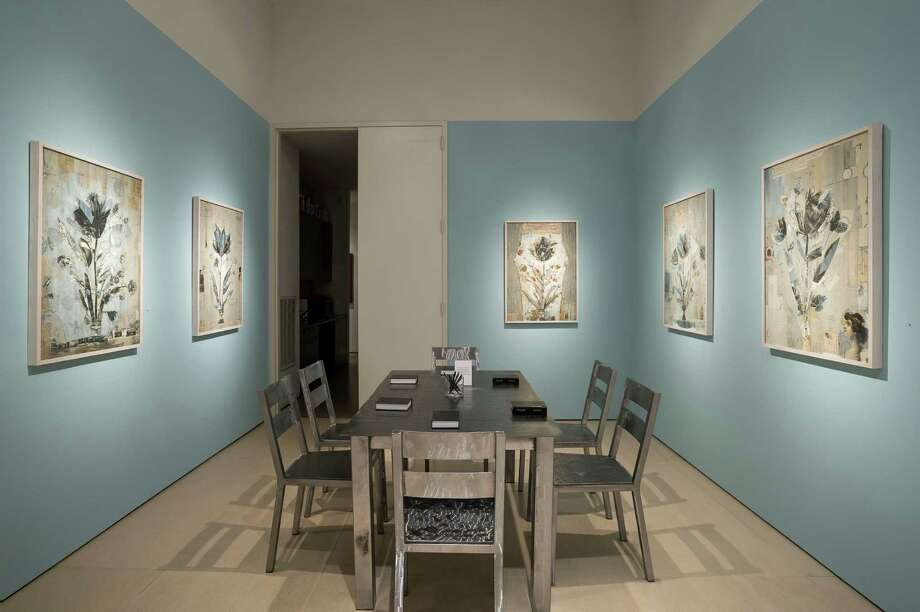 """An installation view of the etched steel table and chairs """"too hot,too cold"""" with monoprint and collage works is among the monoprint and collage works featured in """"Karin Broker: damn girls"""" through May 31 at McClain Gallery. Photo: Nash Baker / ONLINE_YES"""