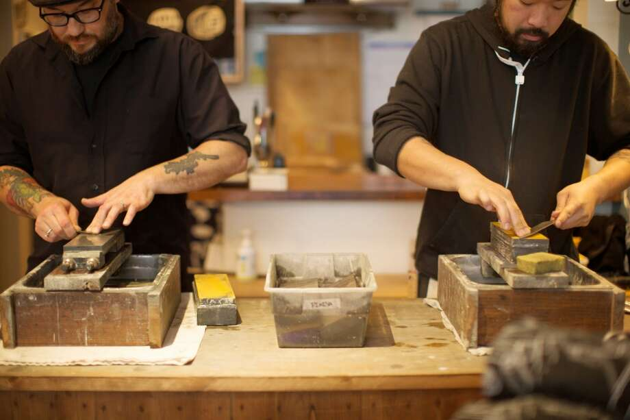 Josh Donald and Taka Tozawa sharpening knives at Bernal Cutlery Photo: Molly DeCoudreaux Photography
