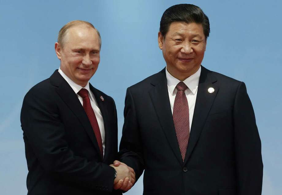 President Barack Obama cites modern rules when dealing with Asia. Russian President Vladimir Putin (left) and Chinese President Xi Jinping look to ancient maps and resurgent nationalism as they ignore him and redefine the global balance of power. Photo: Aly Song / AFP / Getty Images / AFP