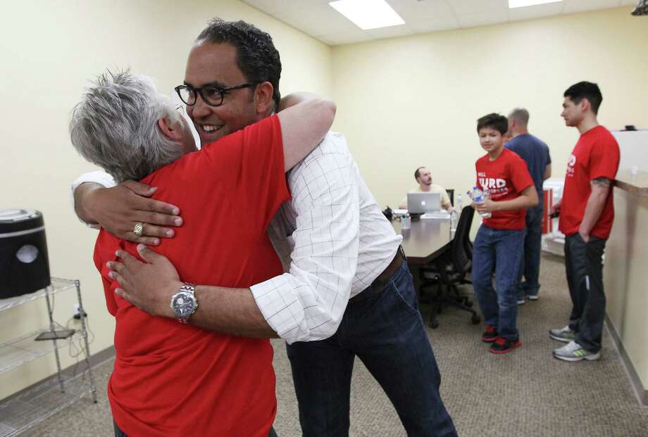 """Republican U.S. Congress hopeful Will Hurd hugs  a supporter before heading out to block walk a neighborhood around Shavano Park on Saturday, May 17, 2014. Hurd is in a runoff race to be the Republican District 23 Congressional nominee against Francisco """"Quico"""" Canseco. The run-off election will be held on May 27. Early voting begins Monday. Photo: Kin Man Hui, San Antonio Express-News / ©2014 San Antonio Express-News"""