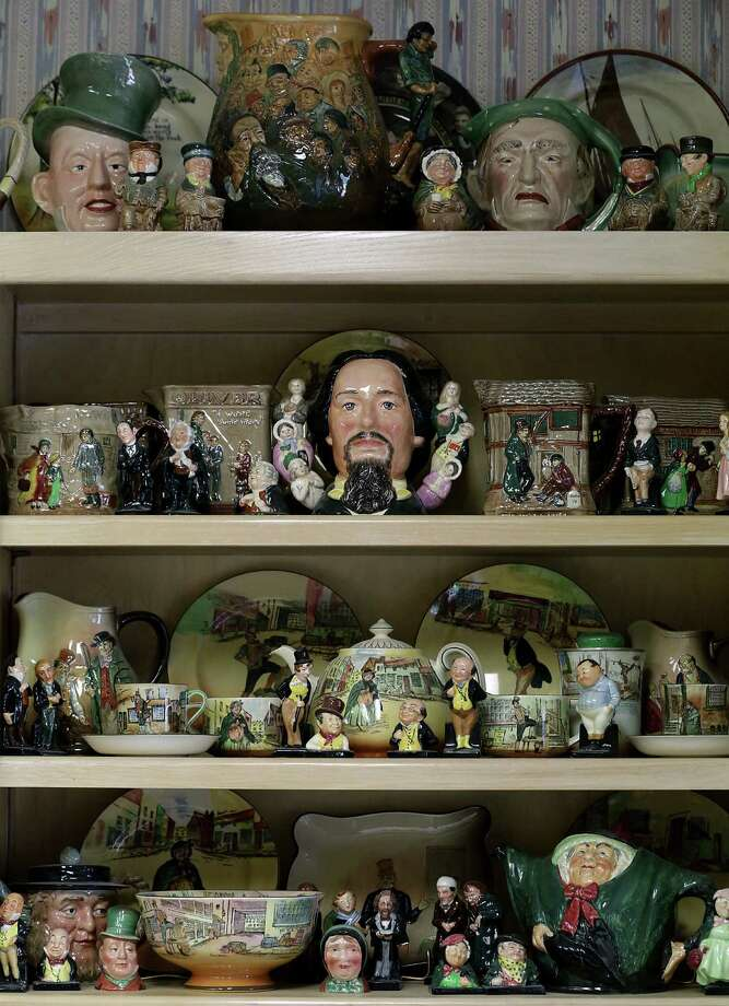 Characters from Charles Dickens stories are among the Doulton pieces displayed in the home of Ann and George Berg. Photo: Bob Owen / San Antonio Express-News / © 2012 San Antonio Express-News