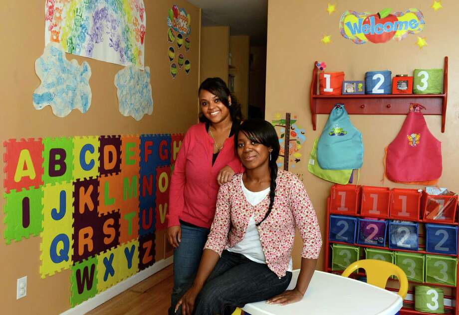 """Angela Spruill, left, and Dawn Sockwell recently opened H.U.G. Help """"U"""" Grow Child Care LLC together in Ansonia, Conn. The business owners attend the Community Business School (CBS), a series of free courses offered by the Greater New England Minority Supplier Development Council, to learn how to be successful entrepreneurs. Photo: Autumn Driscoll / Connecticut Post"""