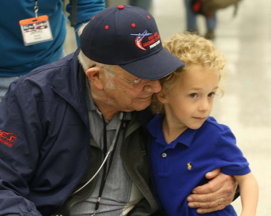 3. Montana. Pictured: Eli Wilke, 6, gives Billings World War II veteran and Montana resident Donald Buska, left, a hug. Photo: Lloyd Blunk, Associated Press