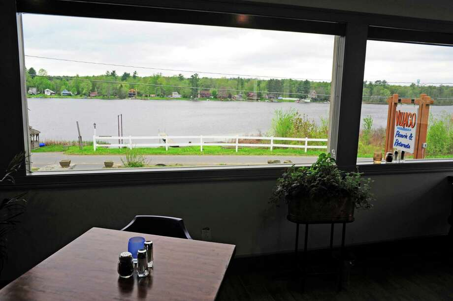 A view looking out at Ballston Lake from inside Villago Pizzeria & Ristorante on Thursday, May 15, 2014, in Ballston Lake, N.Y.   (Paul Buckowski / Times Union) Photo: Paul Buckowski / 00026909A