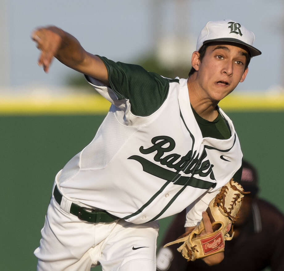 Reagan's go-to pitcher Troy Montemayor throws  against Churchill in late April. Photo: Darren Abate / For The Express-News / San Antonio Express-News