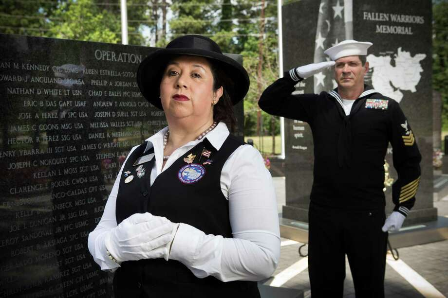 Roxana Board and her husband, retired Navy Petty Officer 1st Class Darrell Board, pictured at the Fallen Soldiers Memorial in Cy-Champ Park, attend the funerals of veterans to show support for those who have served in the military. Photo: Brett Coomer, Staff / © 2014 Houston Chronicle