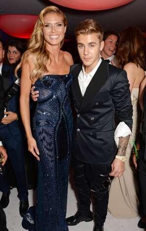 Heidi Klum (L) and Justin Bieber attend amfAR's 21st Cinema Against AIDS Gala after party. Photo: Dave M. Benett/amfAR14, WireImage