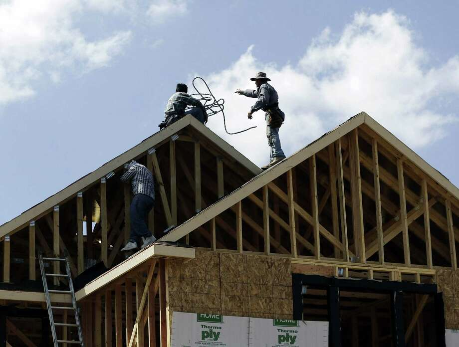 SAWS' proposal would price some potential homebuyers out of the market. Photo: Eric Gay / Associated Press / AP