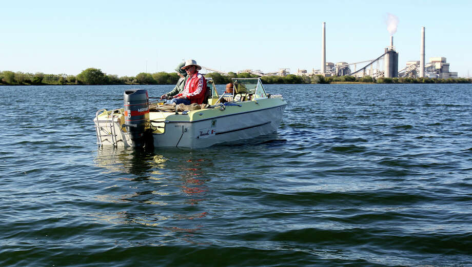 CALAVERAS (freshwater): Water murky. Black bass are slow. Striped bass are slow. Redfish are slow. Channel catfish are slow. Blue catfish are slow. Yellow catfish are slow. Photo: TOM REEL, San Antonio Express-News / © 2011 San Antonio Express-News