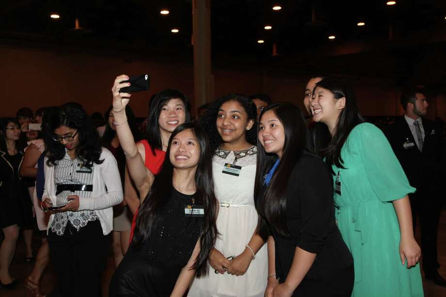 Jennifer Ho, an Opportunity Scholar, takes a selfie with other scholarship recipients during a Houston Livestock Show and Rodeo banquet. / Houston Livestock Show and Rodeo