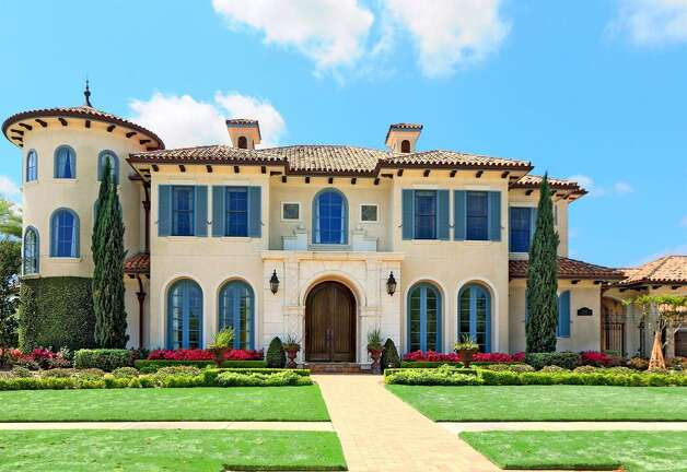 5622 Lakeshore Vista near Rosenberg: Rosenberg came in at No. 6 on the most boring cities in Texas list but this 2007 Mediterranean-style mega home has plenty of ways to spend your time. The cool property has a sparkling pool with fountains, outdoor kitchen area with TV and fireplace, lakefront fire pit, movie theater, 6 bedrooms, 5 full and 2 half bathrooms, and 7,478 square feet. Listed for $2,500,000. Photo: Houston Association Of Realtors